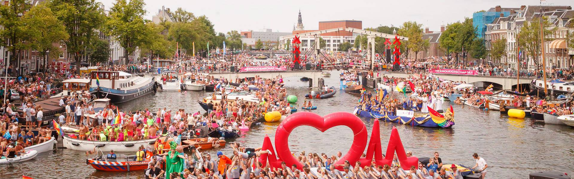 Large inflatable promotional material | X-Treme Creations A gigantic inflatable heart rate line (ECG) on the canal of Amsterdam during the Gay Pride with celebrating people Universitair Medisch Centrum Amsterdam  X-Treme Creations
