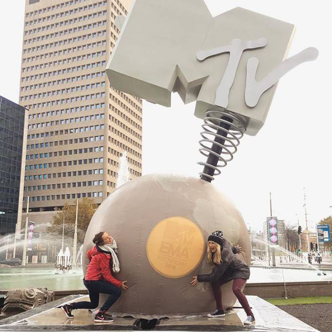 Large inflatable promotional material | X-Treme Creations 2 women posing with MTV Globe in front of fountain with high building in background Events  & Brand activation  &  VKN Projecten X-Treme Creations