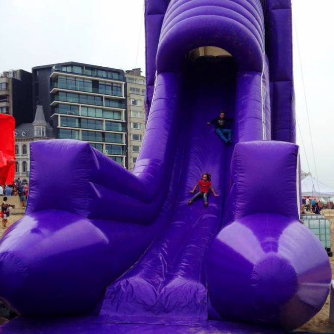 Large inflatable promotional material | X-Treme Creations Purple inflatable slide with children Events  & Corporate branding  & Brand activation  &  Proximus Demonstr8 X-Treme Creations